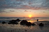 stock photo of breathtaking  - Breathtaking view of amazing sunset in a beautiful beach of Manabi - JPG