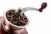 Постер, плакат: Fresh Coffee Bean And Coffee Bean Grinder Closeup