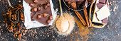 pic of chocolate spoon  - Chocolate in plates and spices in the spoons on black table - JPG