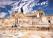 stock photo of altar  - The Altare della Patria or Altar of the Fatherland against blue sky - JPG