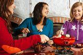 Three Women Having Fondue Dinner