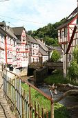 foto of wrought iron  - Creek lined with historic houses and wrought iron railing in the medieval village of Monreal in the river Rhine area of Germany - JPG