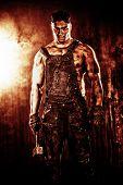 image of minerals  - Handsome muscular coal miner with a hammer over dark grunge background - JPG