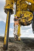 picture of foundation  - Manual worker fixing drilling pile foundation - JPG