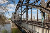 stock photo of old bridge  - Old iron railroad bridge in Frankfurt Main Germany - JPG