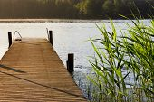 stock photo of pier a lake  - Lake and pier at summer morning in finland - JPG