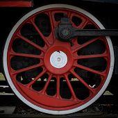 pic of locomotive  - Vintage wheel of old steam locomotive background - JPG