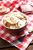 image of liver fry  - Tasty dumplings with fried onion in brown bowl - JPG