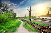 stock photo of electric station  - Electric poles on a railway station at sunrise - JPG