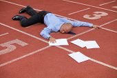 picture of race track  - View of a businessman lying on a race track - JPG