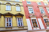 stock photo of tenement  - The old historical tenements at the Old Market Square in Cracow Poland  - JPG