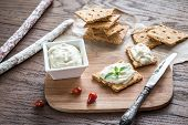 foto of crisps  - Crisps With Cream Cheese On The Wooden Board - JPG