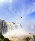 pic of waterfalls  -  White whipped foam of water and a thin mist over the water - JPG
