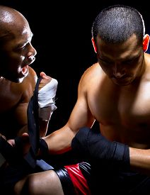 stock photo of pep talk  - Trainer motivating a muscular Boxer or MMA fighter with pep talks - JPG