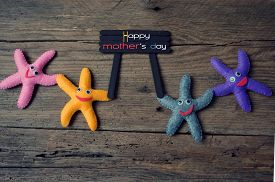 image of i love you mom  - Happy mothers day with i love you mom message idea from colorful fabric starfish on wooden background abstract wooden texture mother - JPG