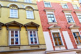 image of tenement  - The old historical tenements at the Old Market Square in Cracow Poland  - JPG
