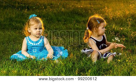 Two Girls Sisters Sitting