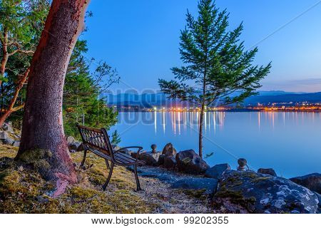 Tranquil sunset and evening illuminations of the beautiful town of Nanaimo on Pacific Ocean in Vancouver, Canada.