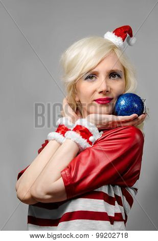 Girl Dressed As Santa Claus With Christmas Ball
