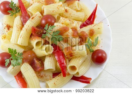 Pasta With Cherry Tomatoes, Parsley And Red Pepper Served With A Tomato Sauce Close Up
