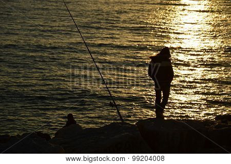 Two Fishermen Waiting For The Fish