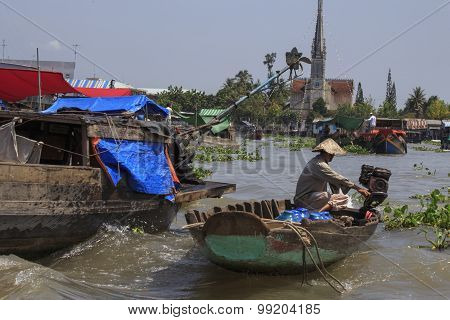People On A Boat At The Floating Market, Vietnam.