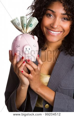 Smiling black woman holding pink piggy bank