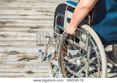 Woman sitting in self propelled wheelchair