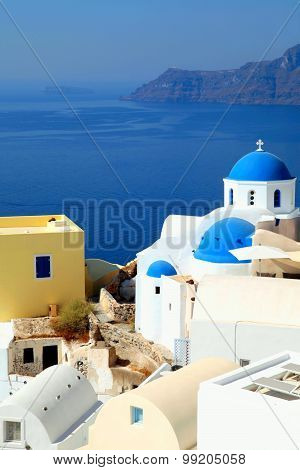 White And Blue Orthodox Church In The Village Of Oia, Santorini Island, Greece.