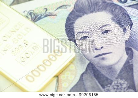 Japanese Five Thousand Yen Bill, A Macro Close-up With Gold Bullion