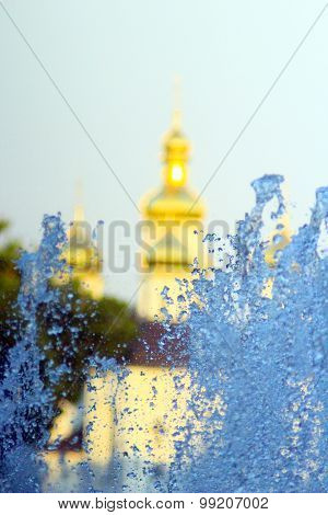 Fountains On The Background Of Golden Domes