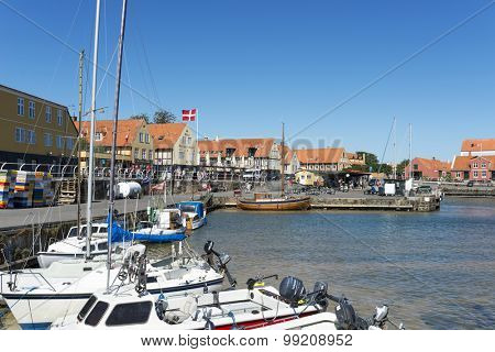 SVANEKE - AUGUST 14 Tourists enjoy the sunny weather and walking along the quay at the port on 14 August 2015 in Svaneke on Bornholm Island, Denmark.