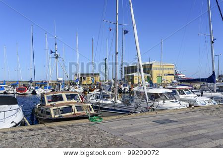 NEXO - AUGUST 14: View of the marina full of sailing boats and fishing boats in summer sunny day on 14 August 2015 in Nexo on Bornholm Island, Denmark.