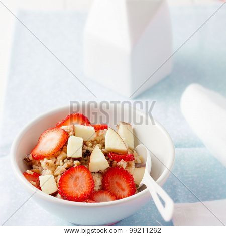 breakfast - oatmeal or porrige with strawberries, apples and nuts