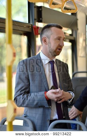 ST. PETERSBURG, RUSSIA - AUGUST 17, 2015: Vice president and senior business development manager of Mastercard Anton Shigapov demonstrate the PayPass technology in urban transport ticketing system