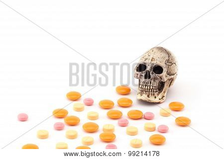 Human skull and drugs on isolated white background.