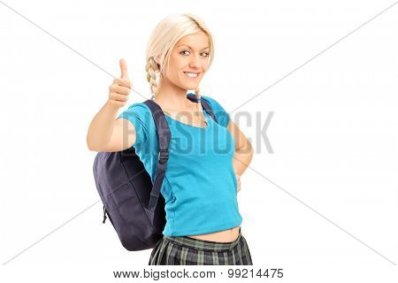 Schoolgirl giving a thumb up isolated on white background