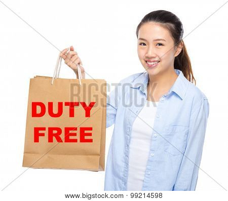 Young woman with shopping bag ans showing duty free