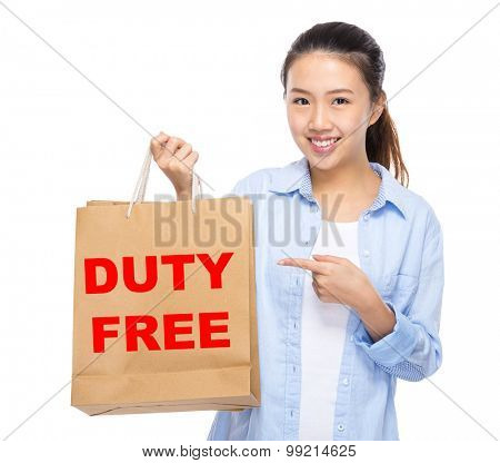 Asian woman finger point to shopping bag and showing duty free