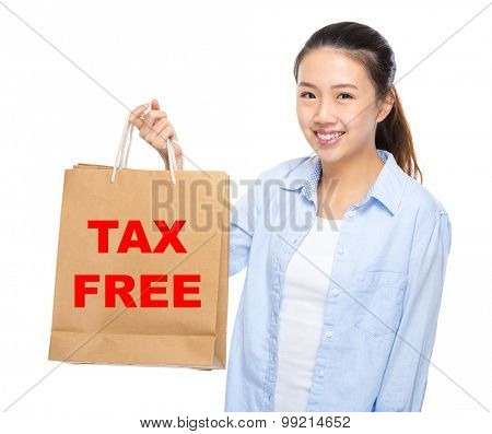 Young woman with shopping bag ans showing tax free