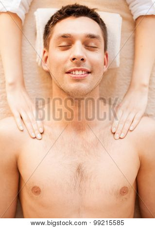 close up of man face in spa salon getting massage