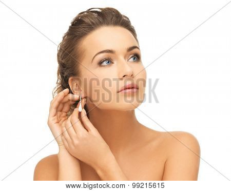 beauty and jewelry concept - beautiful woman wearing shiny diamond earrings
