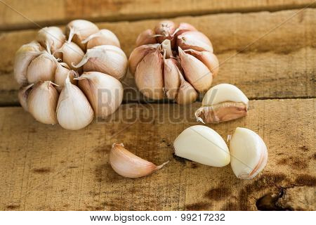 Garlic on the wooden background, Close up garlic on wooden table, Raw garlic in kitchen rooms