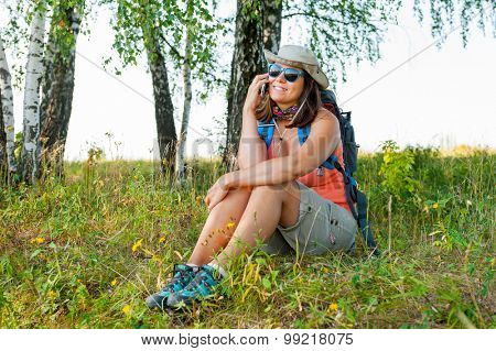 Young woman traveler talking by mobile phone