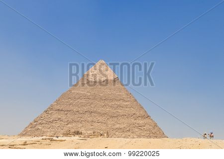 Giza Pyramids and camel riders - Cairo, Egypt
