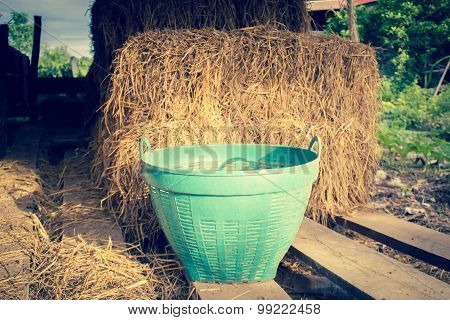 Green Plastic Basket With Hay Stack Background
