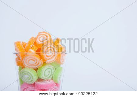 Jelly Sweet, Flavor Fruit, Candy Dessert Colorful In Glass On White Paper Background