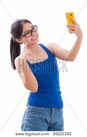 young woman taking selfie picture in the studio