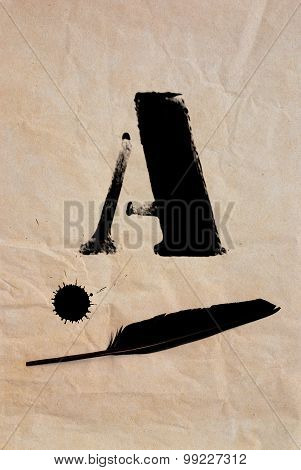A - Letter And Black Feather On Brown Paper Surface
