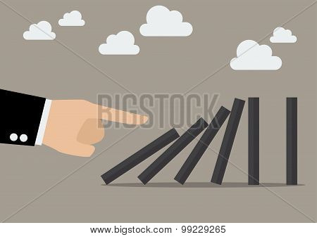 Businessman Hand Pushing The Domino Tiles